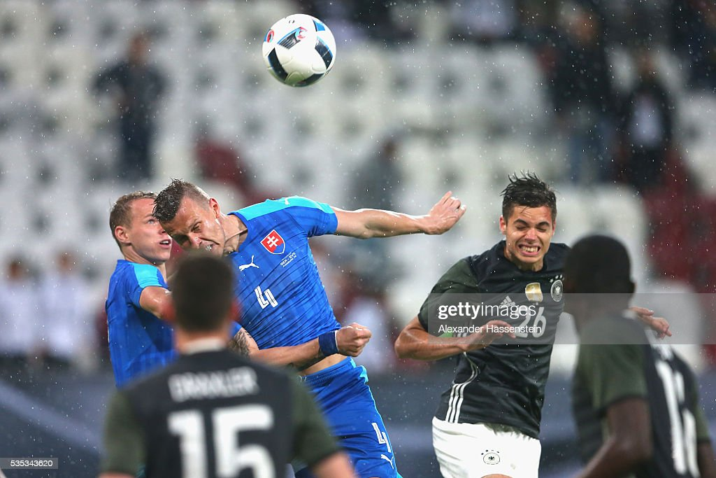 Julian Weigl (R) of Germany battles for the ball with <a gi-track='captionPersonalityLinkClicked' href=/galleries/search?phrase=Jan+Durica&family=editorial&specificpeople=765416 ng-click='$event.stopPropagation()'>Jan Durica</a> of Slovakia during the international friendly match between Germany and Slovakia at WWK-Arena on May 29, 2016 in Augsburg, Germany.