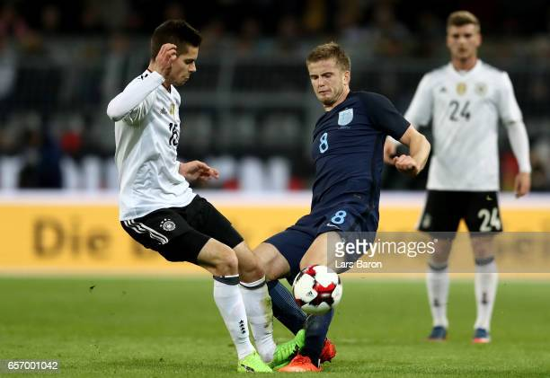 Julian Weigl of Germany challenges Eric Dier of England during the international friendly match between Germany and England at Signal Iduna Park on...