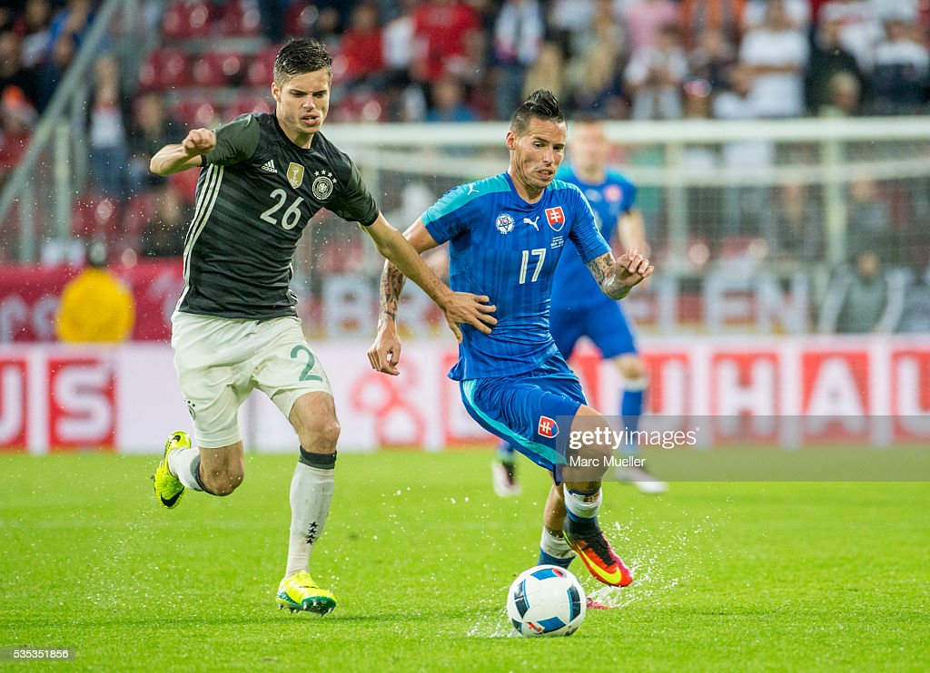 Julian Weigl (L) of Germany is challenged by <a gi-track='captionPersonalityLinkClicked' href=/galleries/search?phrase=Marek+Hamsik&family=editorial&specificpeople=4321724 ng-click='$event.stopPropagation()'>Marek Hamsik</a> of Slovakia during during the international friendly match between Germany and Slovakia at WWK-Arena on May 29, 2016 in Augsburg, Germany.