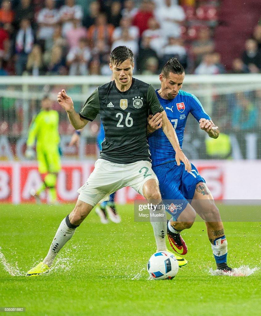 Julian Weigl (L) of Germany is challenged by Marek Hamsik of Slovakia during during the international friendly match between Germany and Slovakia at WWK-Arena on May 29, 2016 in Augsburg, Germany.
