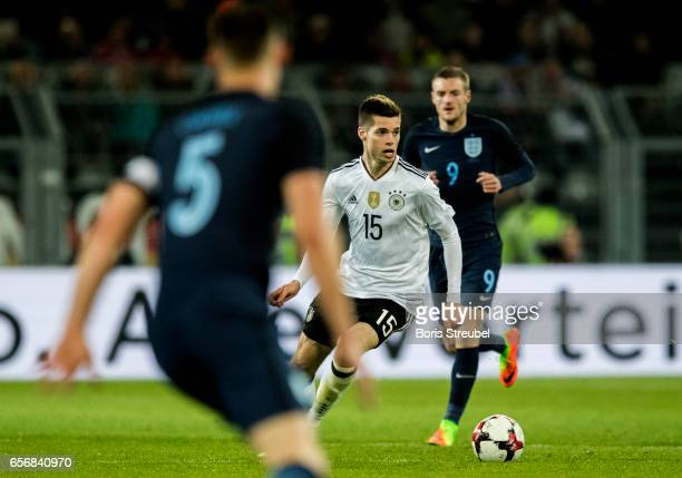 Julian Weigl of Germany is challenged by players of England during the international friendly match between Germany and England at Signal Iduna Park...
