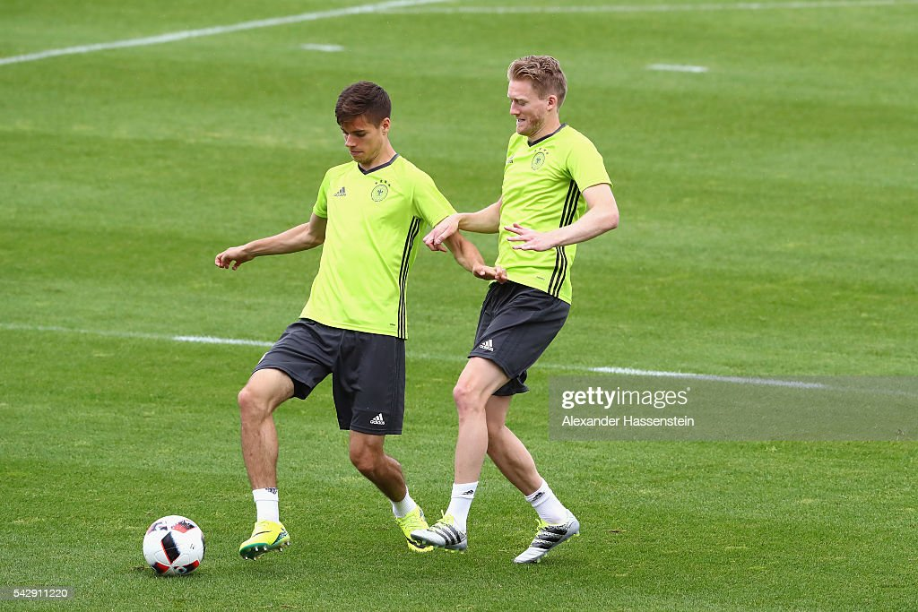 <a gi-track='captionPersonalityLinkClicked' href=/galleries/search?phrase=Julian+Weigl&family=editorial&specificpeople=6850845 ng-click='$event.stopPropagation()'>Julian Weigl</a> (L) of Germany plays the ball with his team mate <a gi-track='captionPersonalityLinkClicked' href=/galleries/search?phrase=Andre+Schuerrle&family=editorial&specificpeople=5513825 ng-click='$event.stopPropagation()'>Andre Schuerrle</a> during a Germany training session ahead of their Euro 2016 round of 16 match against Slovakia at Ermitage Evian on June 25, 2016 in Evian-les-Bains, France.
