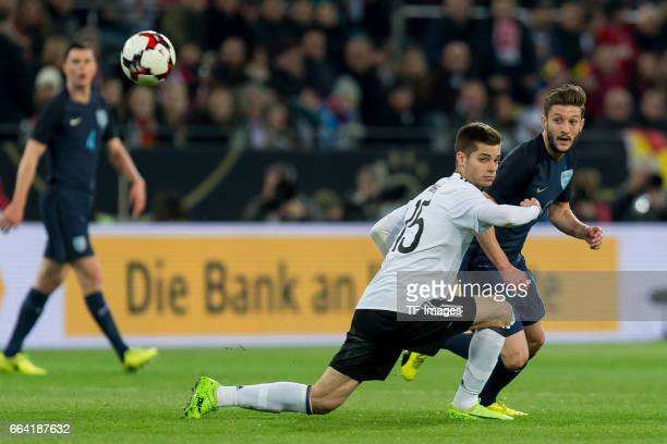 Julian Weigl of Germany und Adam Lallana battle for the ball during the international friendly match between Germany and England at Signal Iduna Park...