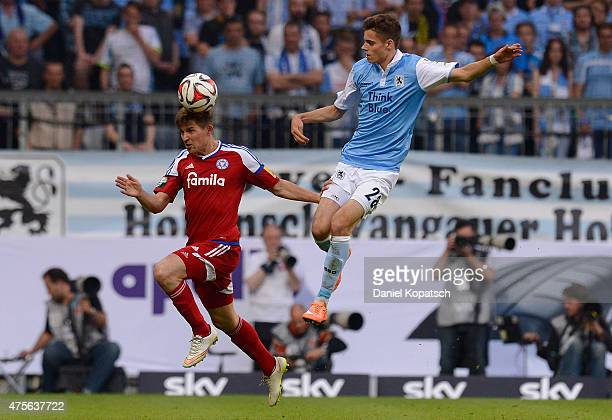 Julian Weigl of Muenchen is challenged by Tim Siedschlag of Kiel during the 2 Bundesliga playoff second leg match between 1860 Muenchen and Holstein...