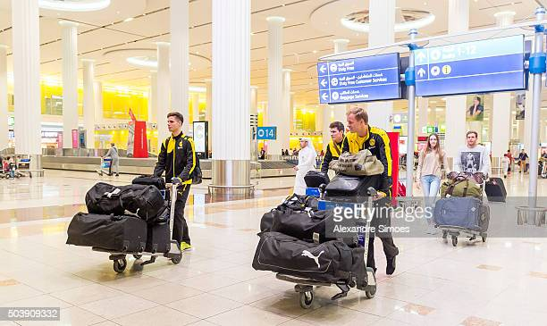 Julian Weigl Pascal Stenzel and goalkeeper Hendrik Bonmann fl of Borussia Dortmund arrival at the international airport in Dubai to their training...