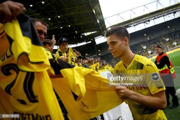 Julian Weigl writes autographs during the Borussia Dortmund Season Opening 2017/18 at Signal Iduna Park on August 4 2017 in Dortmund Germany