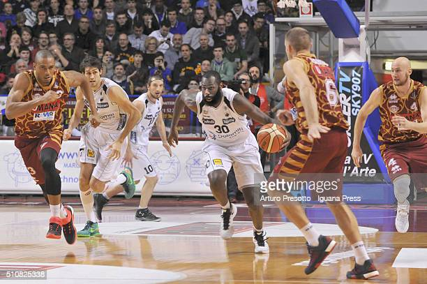 Julian Wright of Dolomiti Energia competes with Josh Owens and Michael Bramos and Hrvoje Peric of Umana during the LegaBasket match between Reyer...