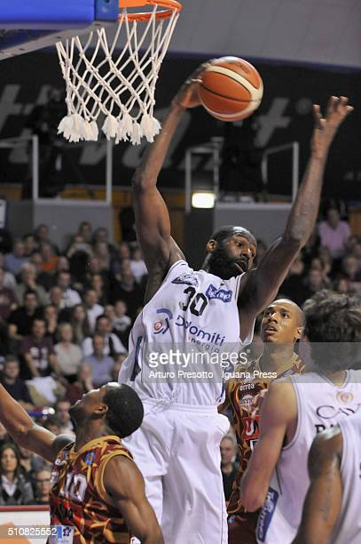 Julian Wright of Dolomiti Energia competes with Mike Green and Josh Owens of Umana during the LegaBasket match between Reyer Umana Venezia and Aquila...