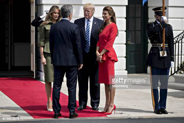 Juliana Awada first lady of Argentina from right US President Donald Trump Mauricio Macri Argentina's president and US First Lady Melania Trump talk...