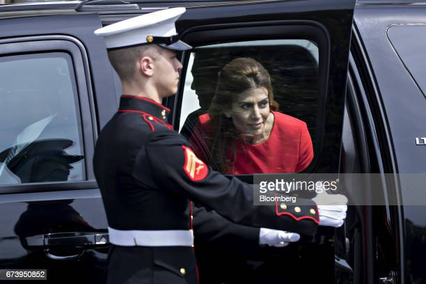 Juliana Awada first lady of Argentina gets out of her vehicle with Mauricio Macri Argentina's president center left to greet US President Donald...