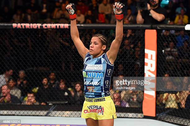 Juliana Pena celebrates after defeating Milana Dudieva in their women's bantamweight fight during the UFC Fight Night event at the Patriot Center on...
