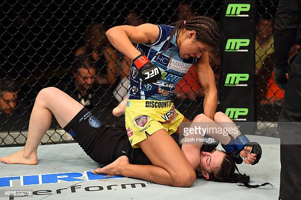 Juliana Pena punches Milana Dudieva on the ground in their women's bantamweight fight during the UFC Fight Night event at the Patriot Center on April...