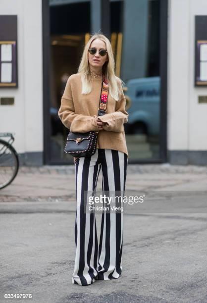 Juliane Diesner wearing a beige Celine sweater Valentino bag Ganni lace top black white striped pants Alice Olivia Gucci shoes at the Copenhagen...