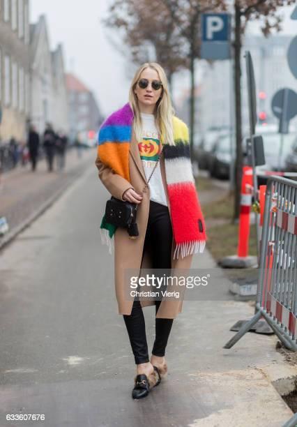 Juliane Diesner wearing a white Gucci shirt black Gucci bag beige coat outside By Malene Birger during the Copenhagen Fashion Week Autumn/Winter 17...