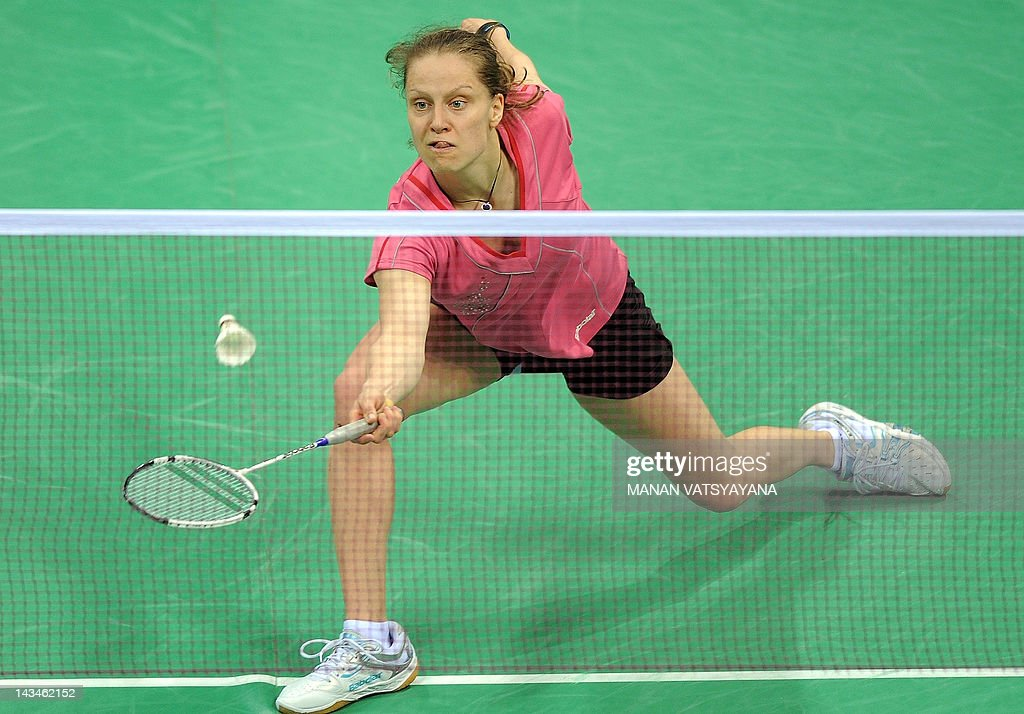 Juliane Schenk of Germany returns a shot against Chinese Badminton player Shixian Wang during the Yonex-Sunrise India Open 2012 at the Siri Fort Sports Complex in New Delhi on April 27, 2012. AFP PHOTO/MANAN VATSYAYANA