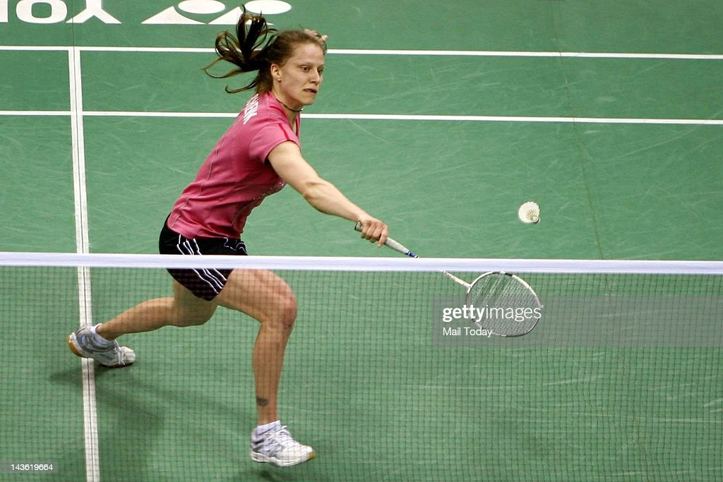 Juliane Schenk of Germany returns a shot against Chinese Badminton player Shixian Wang during the Yonex-Sunrise India Open 2012 at the Siri Fort Sports Complex in New Delhi on April 27, 2012.
