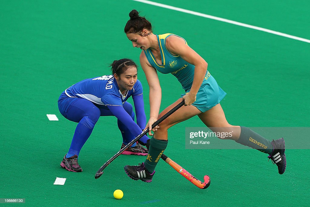 Juliani Mohamad Din of Malaysia challenges Mariah Williams of the Jillaroos in the womens Australia u21 Jillaroos v Malaysia game during day two of the 2012 International Super Series at Perth Hockey Stadium on November 23, 2012 in Perth, Australia.