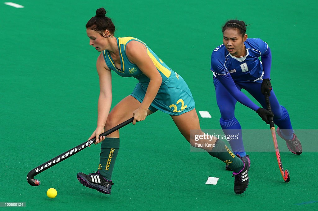 Juliani Mohamad Din of Malaysia looks to challenge Mariah Williams of the Jillaroos in the womens Australia u21 Jillaroos v Malaysia game during day two of the 2012 International Super Series at Perth Hockey Stadium on November 23, 2012 in Perth, Australia.