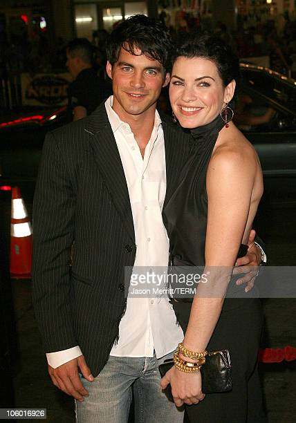 Julianna Margulies and guest during 'Snakes on a Plane' Los Angeles Premiere Arrivals at GraumanIs Chinese Theatre in Hollywood California United...