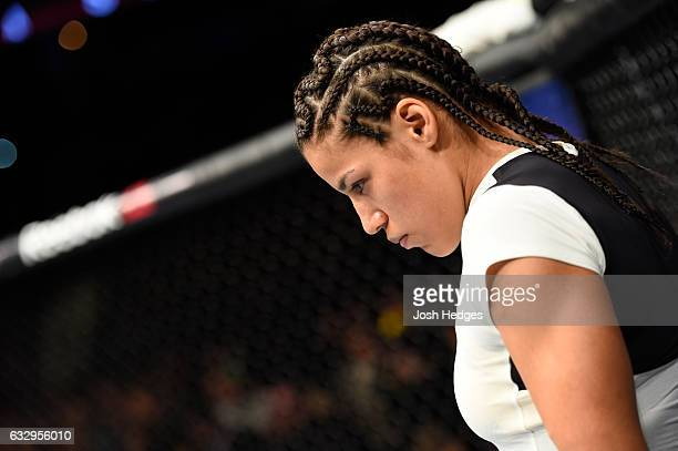 Julianna Pena enters the Octagon before facing Valentina Shevchenko of Kyrgyzstan in their women's bantamweight bout during the UFC Fight Night event...
