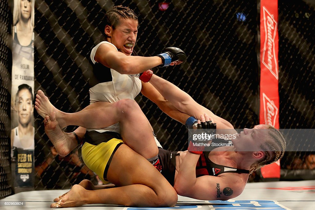 Julianna Pena fights Valentina Shevchenko of Kyrgyzstan in the women's Bantamweight division during the UFC Fight Night at the Pepsi Center on January 28, 2017 in Denver, Colorado.