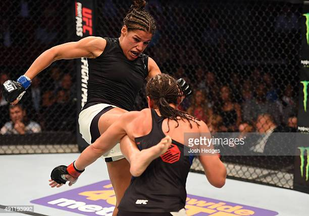 Julianna Pena kicks Jessica Eye in their women's bantamweight bout during the UFC 192 event at the Toyota Center on October 3 2015 in Houston Texas