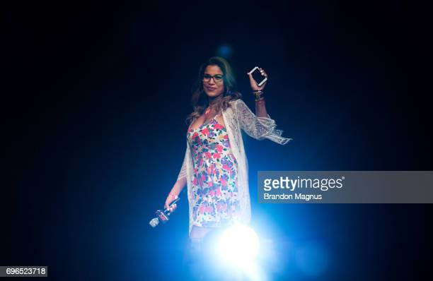 Julianna Pena of the United States waves to the fans UFC Fight Night QA at the Marina Bay Sands on June 16 2017 in Singapore