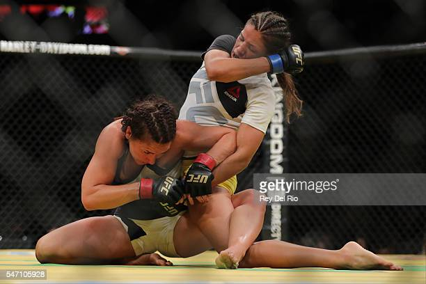 Julianna Pena punches Cat Zingano during the UFC 200 event at TMobile Arena on July 9 2016 in Las Vegas Nevada