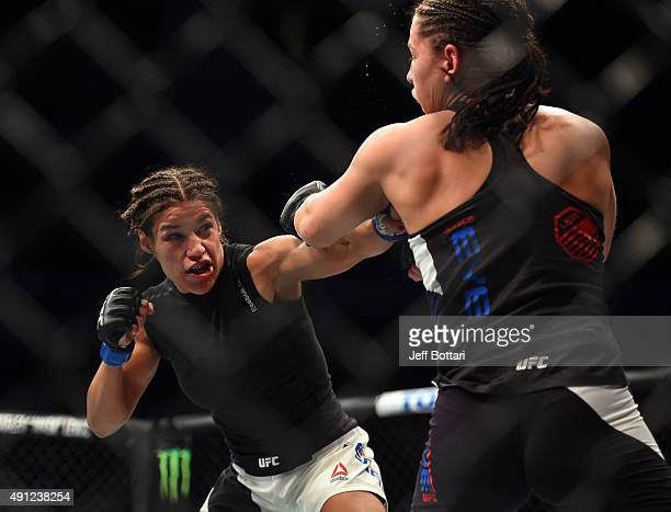 Julianna Pena punches Jessica Eye in their women's bantamweight bout during the UFC 192 event at the Toyota Center on October 3 2015 in Houston Texas