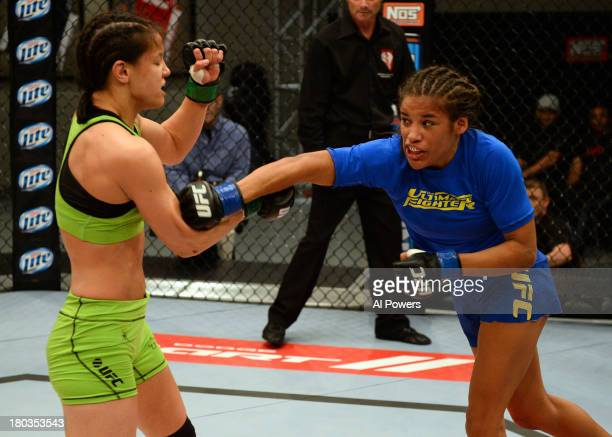 Julianna Pena punches Shayna Baszler in their preliminary fight during filming of season eighteen of The Ultimate Fighter on June 6 2013 in Las Vegas...