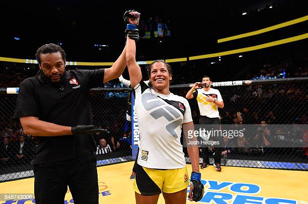 Julianna Pena reacts to her victory over Cat Zingano in their women's bantamweight bout during the UFC 200 event on July 9 2016 at TMobile Arena in...