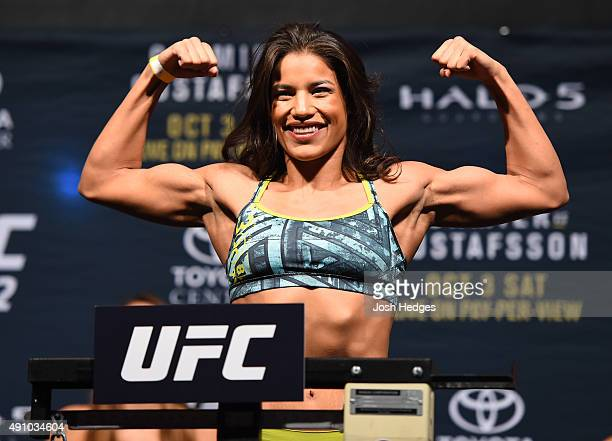 Julianna Pena steps on the scale during the UFC 192 weighin at the Toyota Center on October 2 2015 in Houston Texas
