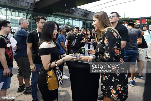Julianna Penna greets fans at the Harley Davidson booth during the UFC Fan Experience at OCBC Square on June 17 2017 in Singapore