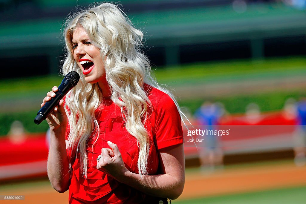 Julianna Zobrist, wife of Ben Zobrist #18 (not pictured) of the Chicago Cubs, sings the national anthem before the game between the Chicago Cubs and the Los Angeles Dodgers at Wrigley Field on May 30, 2016 in Chicago, Illinois.