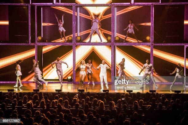 Julianne Hough and Derek Hough perform during Julianne and Derek Hough Move Beyond Live at Microsoft Theater on June 11 2017 in Los Angeles California