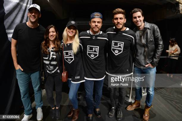 Julianne Hough Derek Hough Lewis Howes and friends pose for a photo during the game between the Los Angeles Kings and the Vancouver Canucks on...