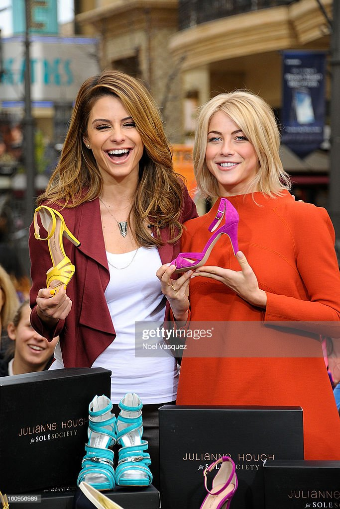 <a gi-track='captionPersonalityLinkClicked' href=/galleries/search?phrase=Julianne+Hough&family=editorial&specificpeople=4237560 ng-click='$event.stopPropagation()'>Julianne Hough</a> displays her new shoes with <a gi-track='captionPersonalityLinkClicked' href=/galleries/search?phrase=Maria+Menounos&family=editorial&specificpeople=203337 ng-click='$event.stopPropagation()'>Maria Menounos</a> at Extra at The Grove on February 7, 2013 in Los Angeles, California.