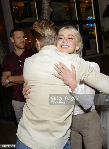 Julianne Hough hugs brother Derek Hough at the Paint Sip Help event to Benefit Children's Hospital Los Angeles hosted by The Grove on October 12 2017...
