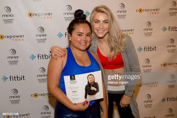 Julianne Hough poses with fan MPG Sport Brand Ambassador Designer and CorePower Yoga Partner to bring free class to Atlanta and promote the launch of...
