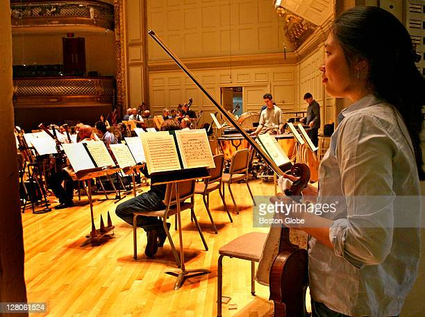 Julianne Lee prepares to go on stage during a rehearsal at Boston Symphony Hall Wednesday Sept 27 2006