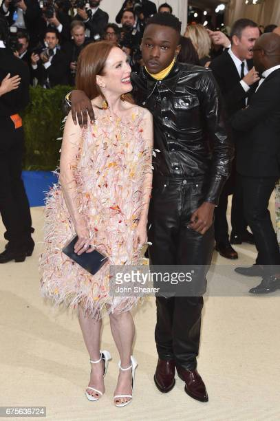 Julianne Moore and Ashton Sanders attend the 'Rei Kawakubo/Comme des Garcons Art Of The InBetween' Costume Institute Gala at Metropolitan Museum of...
