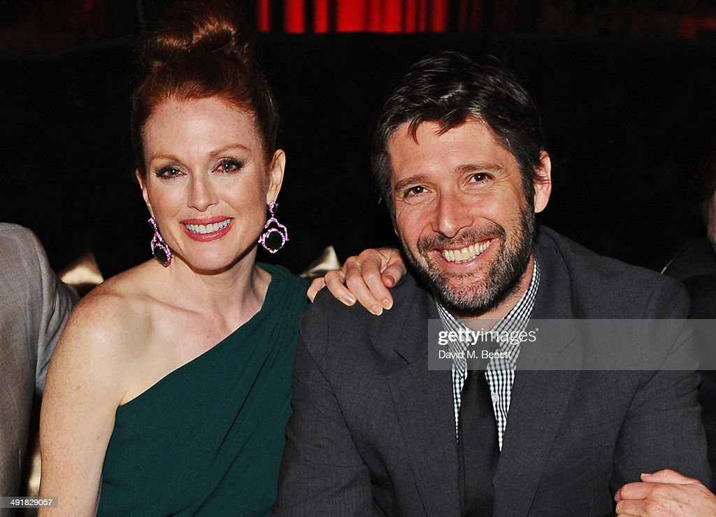 Julianne Moore (L) and Bart Freundlich attend Lionsgate's 'The Hunger Games: Mockingjay Part 1' party at a private villa on May 17, 2014 in Cannes, France.