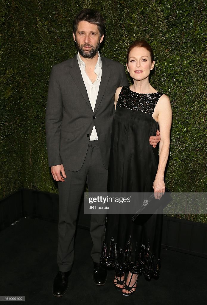 Julianne Moore and Bart Freundlich attend the Chanel And Charles Finch Pre-Oscar Dinner at Madeo Restaurant on February 21, 2015 in West Hollywood, California.