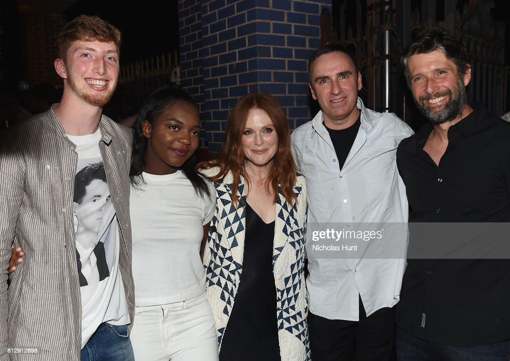 Julianne Moore and designer Raf Simons attend the Raf Simons - Front Row/Backstage at