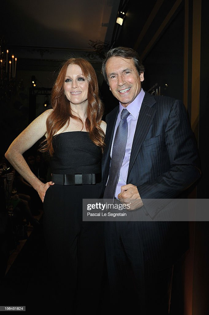 <a gi-track='captionPersonalityLinkClicked' href=/galleries/search?phrase=Julianne+Moore&family=editorial&specificpeople=171555 ng-click='$event.stopPropagation()'>Julianne Moore</a> and Jean Jacques Lebel pose during the l'Oreal new egerie presentation at Hotel D'Evreux on November 15, 2012 in Paris, France.
