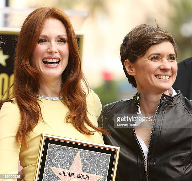 Julianne Moore and Kimberly Peirce attend the ceremony honoring Julianne Moore with a Star on The Hollywood Walk of Fame held on October 3 2013 in...