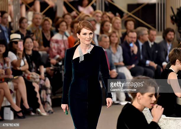 Julianne Moore and Kristen Stewart attend the Chanel show as part of Paris Fashion Week Haute Couture Fall/Winter 2015/2016 at the Grand Palais on...