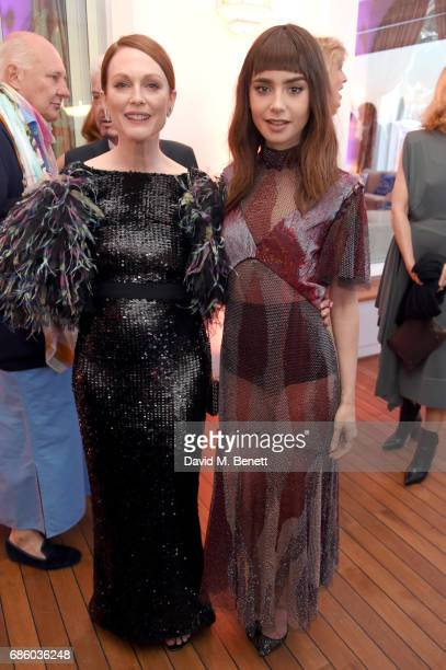 Julianne Moore and Lily Collins attend the Vanity Fair and HBO Dinner celebrating the Cannes Film Festival at Hotel du CapEdenRoc on May 20 2017 in...