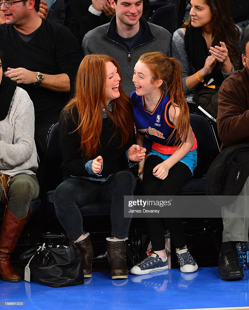 Julianne Moore and Liv Helen Freundlich attend the Minnesota Timberwolves vs New York Knicks game at Madison Square Garden on December 23, 2012 in New York City.