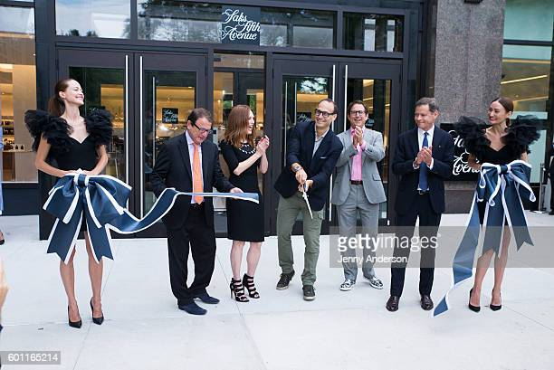 Julianne Moore and President of Saks Fifth Avenue Marc Metrick attend Saks Downtown Ribbon Cutting at Saks Downtown on September 9 2016 in New York...